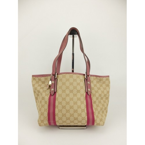 0d165e55374 Gucci GG Canvas Leather.